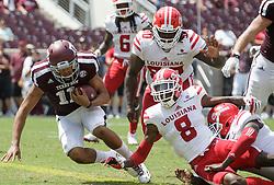 Texas A&M quarterback Kellen Mond (11) evades Louisiana-Lafayette defensive back Simeon Thomas (8) for a touchdown during the third quarter of an NCAA college football game Saturday, Sept. 16, 2017, in College Station, Texas. (AP Photo/Sam Craft)