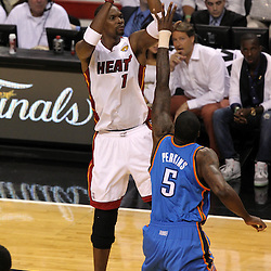 Jun 21, 2012; Miami, FL, USA; Miami Heat power forward Chris Bosh (1) shoots against Oklahoma City Thunder center Kendrick Perkins (5) during the first quarter in game five in the 2012 NBA Finals at the American Airlines Arena. Mandatory Credit: Derick E. Hingle-US PRESSWIRE