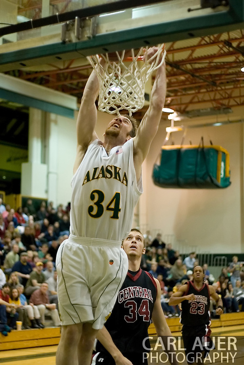 1/6/2006: Junior forward Carl Arts (34) of the UAA Seawolves heads to the rack on a fast break as Anchorage goes on to beat the visiting Central Washington Wildcats, 80-60 at the Wells Fargo Sports Complex on the campus of UAA.<br />