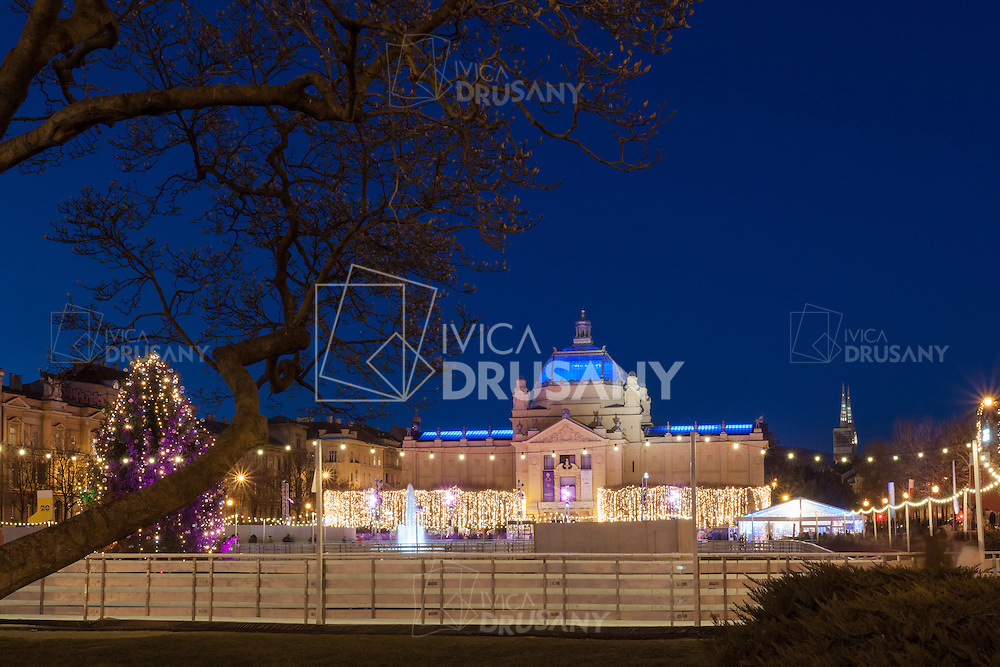 ZAGREB, CROATIA - DECEMBER 24, 2014: The new outdoor ice skating rink on King Tomislav square, one of the most beautiful parks of the Lenuci Horseshoe, located near the Art Pavilion.