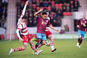 Scunthorpe United midfielder Duane Holmes (19) during the The FA Cup match between Doncaster Rovers and Scunthorpe United at the Keepmoat Stadium, Doncaster, England on 3 December 2017. Photo by Craig Zadoroznyj.