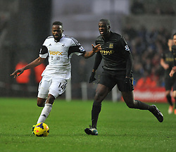 Swansea City's Roland Lamah takes the ball past Manchester City's Micah Richards - Photo mandatory by-line: Alex James/JMP - Tel: Mobile: 07966 386802 01/01/2014 - SPORT - FOOTBALL - Liberty Stadium - Swansea - Swansea City v Manchester City - Barclays Premier League