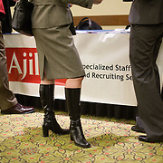 A job seeker speaks to a temp staffing agency recruiter at a job fair at the Rosslyn Holiday Inn in Arlington, VA on Friday, Jan. 15, 2010.