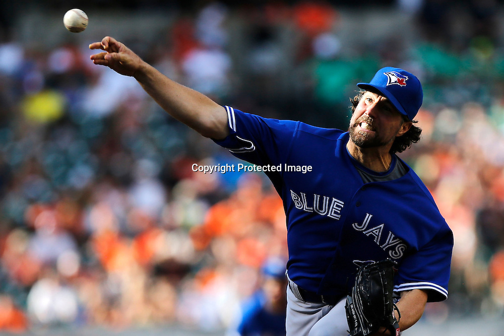 Starting pitcher R.A. Dickey #43 of the Toronto Blue Jays throws to a Baltimore Orioles batter during the sixth inning of their game at Oriole Park at Camden Yards.