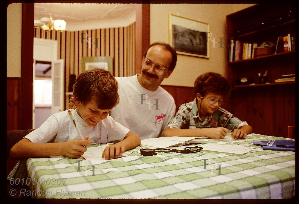 Zel Bodulovic, Yugoslavian immigrant, tutors sons each morning at home before school; Wagga, NSW. Australia