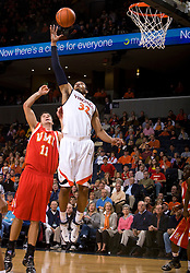 Virginia forward Mike Scott (32) grabs a defensive rebound over Virginia Military forward Quinn Brownfield (11).  The Virginia Cavaliers defeated the Virginia Military Institute Keydets 107-97 in NCAA Basketball at the John Paul Jones Arena on the Grounds of the University of Virginia in Charlottesville, VA on November 16, 2008.