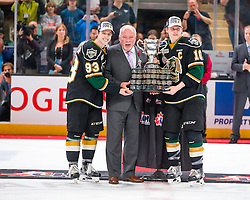 Co Captains Mitch Marner and Christian Dvorak of the London Knights are presented the Memorial Cup by President of the CHL and OHL Commissioner David Branch at the 2016 MasterCard Memorial Cup. Photo by Rob Wallator / CHL Images.