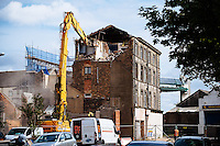 Humber Street, Kingston Upon Hull, East Yorkshire, United Kingdom, 14 August, 2014. Pictured: Demolition of Wellington House, Wellington Street