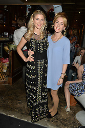Left to right, ASHLEY JAMES and her sister JOELLE JAMES at the launch of Give Me Sport Magazine held at Library, 112 St.Martin's Lane, London on 30th July 2014.