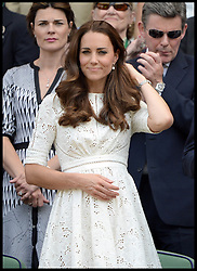 Image ©Licensed to i-Images Picture Agency. 02/07/2014. London, United Kingdom. The Duke and Duchess of Cambridge pull a face as Andy Murray loses the Men's  Quarter Finals on centre court in the Royal box at  Wimbledon. Picture by Andrew Parsons / i-Images