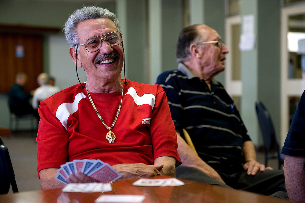 Vince Piscitelli playing cards in the back room at The Italian Club..