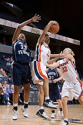 Virginia Cavaliers Guard Britnee Millner (12) grabs a rebound from North Florida Lady Ospreys forward/center Shennette Sheffield (23).  The University of Virginia Cavaliers defeated the North Florida Lady Ospreys Women's Basketball Team 90-57 at the John Paul Jones Arena in Charlottesville, VA on February 6, 2007.