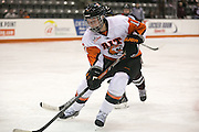 RIT's Carly Payerl chases a puck into the corner during a game at the Gene Polisseni Center on October 3, 2014.
