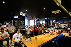 England fans soak up the pre match atmosphere with free England Rugby shirts and refreshments provided in the O2 Blueroom at Belushi's Bar in Paris - Mandatory byline: Rogan Thomson/JMP - 19/03/2016 - RUGBY UNION - Stade de France - Paris, France - France v England - RBS 6 Nations 2016.