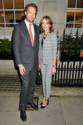 The HON.FREDDIE HESKETH and LADY VIOLET MANNERS at a party to celebrate the publication of Capability Brown & Belvoir - Discovering a lost Landscape by The Duchess of Rutland, held at Christie's, 8 King Street, St.James, London on 7th October 2015.
