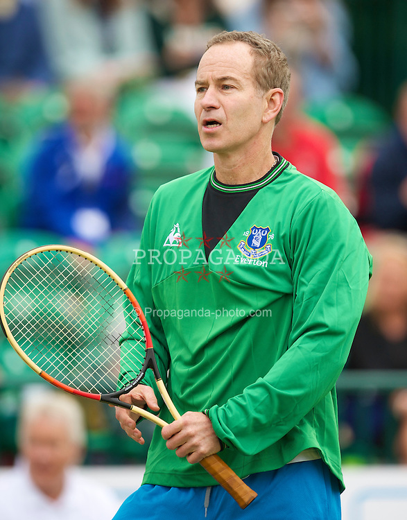 LIVERPOOL, ENGLAND - Friday, June 18, 2010: John McEnroe (USA) wearing an Everton FC shirt of compatriot Tim Howard, in action during the Mixed Doubles on day three of the Liverpool International Tennis Tournament at Calderstones Park. (Pic by David Rawcliffe/Propaganda)