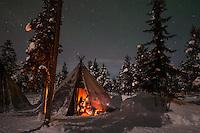 Northern Lights above tents at the reindeer lodge in Jukkasjärvi, Sweden