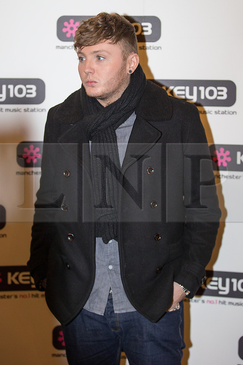 © Licensed to London News Pictures . 08/11/2013 . Manchester , UK . JAMES ARTHUR . Stars in front of the Key 103 brand board at Manchester Town Hall ahead of performing on stage . The Christmas lights are turned on in Manchester this evening (Friday 8th November 2013) . Photo credit : Joel Goodman/LNP