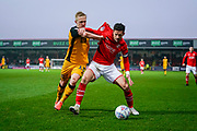 Mathieu Baudry of Swindon Town holds off Mark Cullen of Port Vale from the ball during the EFL Sky Bet League 2 match between Swindon Town and Port Vale at the County Ground, Swindon, England on 25 January 2020.