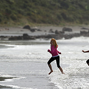 Children play at the water's edge at Oakura Beach, Taranaki, on Surf Highway 45. Taranaki, New Zealand,, 23rd December 2010.  Photo Tim Clayton