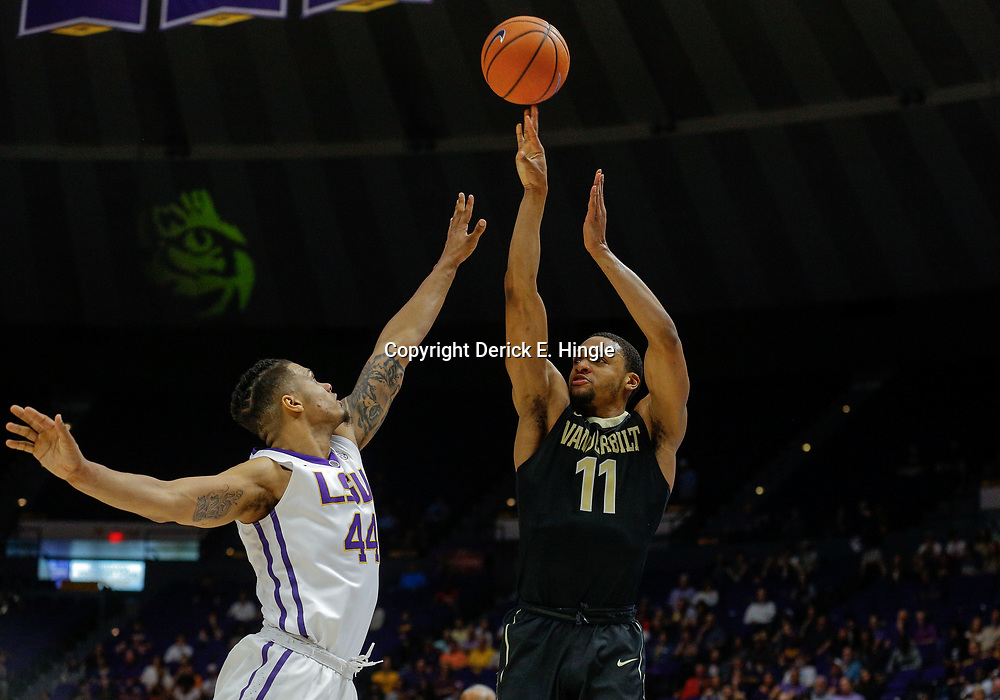 Feb 20, 2018; Baton Rouge, LA, USA; Vanderbilt Commodores forward Jeff Roberson (11) shoots over LSU Tigers forward Wayde Sims (44) during the first half at the Pete Maravich Assembly Center. Mandatory Credit: Derick E. Hingle-USA TODAY Sports