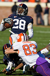 Clemson wide receiver Nelson Faerber (83) brings down Virginia defensive back Rodney McLeod (28) on a kick return.  The Clemson Tigers defeated the Virginia Cavaliers 13-3 in NCAA Division 1 football at Scott Stadium on the Grounds of the University of Virginia in Charlottesville, VA on November 22, 2008.