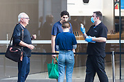 Sydney, Australia. Thursday 7th May 2020. The Apple Store at Bondi Junction in Sydney's eastern suburbs opens as well as all the other Apple stores across Australia as the coronavirus lockdown restrictions ease. Apple has added additional safety procedures including temperature checks and social distancing. Customers having their temperatures checked.Credit Paul Lovelace/Alamy Live News