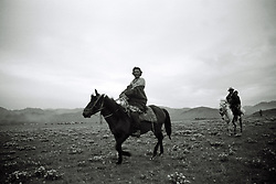 China, Xiahe, 2005. Nomads from camps far away make it to the ceremonies before the annual horse race high up on the Sanke Plain.