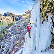 Greg Moore climbs a route called Lower Falls Right near Shoshone Falls in Idaho