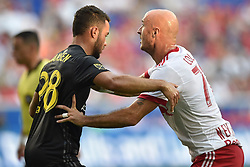 July 28, 2018 - Harrison, New Jersey, U.S - New York Red Bulls defender AURÉLIEN COLLIN (78) and Columbus Crew SC Midfielder NIKO HANSEN (28) grapple in the box at Red Bull Arena in Harrison New Jersey Columbus defeats New York 3 to 2 (Credit Image: © Brooks Von Arx via ZUMA Wire)