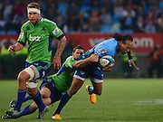 PRETORIA, South Africa, 18 MAY 2013 : Akona Ndungane of the Bulls is tackled by Shaun Treeby with Josh Bekhuis (left) of the Highlanders in support during the SupeRugby match between the BULLS and the HIGHLANDERS at Loftus Versfeld in Pretoria, South Africa on 18 MAY 2013. Bulls 35 - 18 Highlanders.<br /> <br /> © Anton de Villiers / SASPA