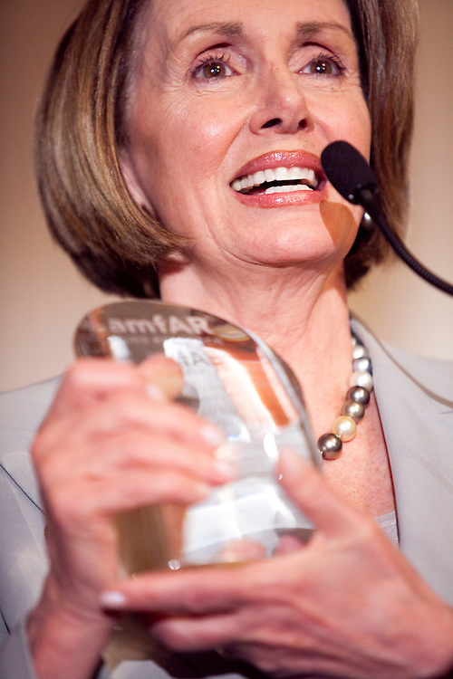 House Speaker Nancy Pelosi (D-CA) accepts the Award of Courage from amfAR (the Foundation for AIDS Research) at a forum on HIV/AIDS on Capitol Hill on May 13, 2009 in Washington, DC.