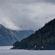 Three weeks aboard the Kong Harald. Hurtigruten, the Coastal Express. Landscape near Alesund and the Geirangerfjolrd.