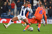 West Bromwich Albion midfielder Jake Livermore (8) attempts to block Millwall midfielder Shaun Williams (6) during the EFL Sky Bet Championship match between West Bromwich Albion and Millwall at The Hawthorns, West Bromwich, England on 22 September 2018.