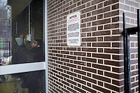 3 February, 2009. New York, NY. Two students wait inside the main entrance of the Louis D. Brandeis High School. Brandeis High School will be closed by the City in order to have smaller high schools.<br /> <br /> ©2009 Gianni Cipriano for The New York Times<br /> cell. +1 646 465 2168 (USA)<br /> cell. +1 328 567 7923 (Italy)<br /> gianni@giannicipriano.com<br /> www.giannicipriano.com