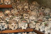 Austria, Upper Austria, Salzkammergut, Hallstatt. Painted skulls in the ossuary at Charnel House