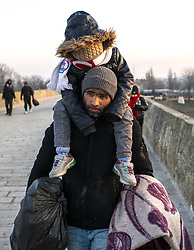 Refugees wait in front of the Greek border at Pazarkule gate, in Edirne, Turkey, on March 01, 2020. Turkey will no longer stop Syrian irregular migrants from reaching Europe, a senior Turkish official said, as Ankara responded on Feb. 29 to the killing of 33 Turkish soldiers in an airstrike by Syrian government forces in Syria's northwestern Idlib region. Photo by Ihsan Sercan Ozkurnazli/Depo Photos/ABACAPRESS.COM