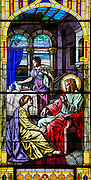 Stained glass image from St. Joseph Church in Kellnersville, Wis., depicts Jesus visiting with Mary and Martha. (Sam Lucero photo)