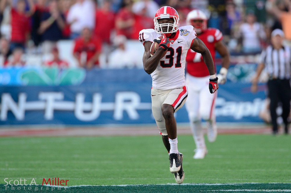 Georgia Bulldogs receiver Chris Conley (31) scores during the Bulldogs 45-31 win over the Nebraska Cornhuskers in the Capital One Bowl at the Florida Citrus Bowl on Jan 1, 2013 in Orlando, Florida. ..©2012 Scott A. Miller..