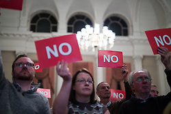 "© Licensed to London News Pictures . 18/11/2014 . Kent , UK . Audience voting "" NO "" in response to a question at a hustings in the Rochester and Strood by-election , held at the Corn Exchange in Rochester , this evening ( 18th November 2014 ) . Photo credit : Joel Goodman/LNP"