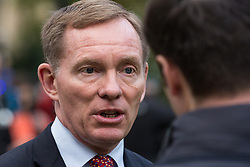 London, UK. 15th November, 2018. Chris Bryant, Labour MP for Rhondda, appears on College Green in Westminster following the Cabinet resignations of Brexit Secretary Dominic Raab and Work and Pensions Secretary Esther McVey the day after Prime Minister gained Cabinet approval of a draft of the final Brexit agreement