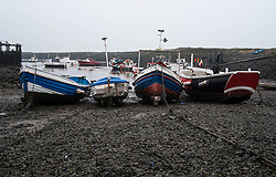 © Licensed to London News Pictures. <br /> 17/03/2015. <br /> <br /> South Gare, Teesside.<br /> <br /> Fishing boats are moored up at low tide at an area known as Paddy's Hole at South Gare on the mouth of the River Tees.<br /> <br /> Photo credit : Ian Forsyth/LNP