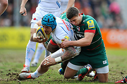 Jack Nowell of Exeter Chiefs is tackled by Ben Youngs of Leicester Tigers - Photo mandatory by-line: Patrick Khachfe/JMP - Mobile: 07966 386802 28/03/2015 - SPORT - RUGBY UNION - Leicester - Welford Road - Leicester Tigers v Exeter Chiefs - Aviva Premiership