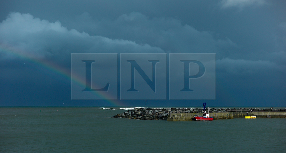 © Licensed to London News Pictures.12/09/15<br /> Staithes, UK. <br /> <br /> A rainbow is seen over the harbour in Staithes on the North Yorkshire coast as thundery showers broke out across the north of England.<br /> <br /> Photo credit : Ian Forsyth/LNP