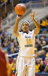West Virginia Mountaineers forward Teana Muldrow (11) shoots a three pointer during the first half at the WVU Coliseum.
