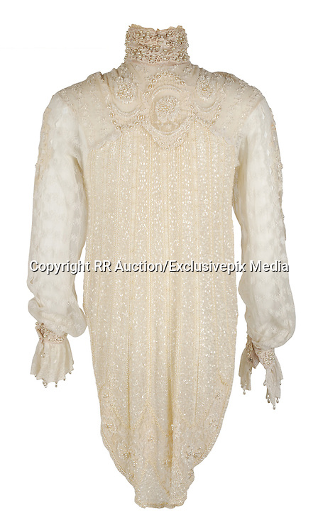 Prince wardrobe and memorabilia; including Beaded Jacket from &lsquo;Under the Cherry Moon&rsquo; to be auctioned  <br /> <br /> Prince's exquisitely made screen-worn beaded jacket from the 1986 film &lsquo;Under the Cherry Moon&rsquo; will be auctioned by Boston-based RR Auction. <br /> <br /> The stunning lace jacket is covered in intricate, shimmering beadwork and faux pearls, and features a bolero-style front with a long, cape back. The jacket is easily photo-matched to the scene in the film where Prince and Mary are in the convertible under the full moon. <br /> <br /> &quot;This piece has never been laundered due to the delicate beading, and Prince's makeup is still present on the collar,&rdquo; said Robert Livingston, Executive VP at RR Auction. <br /> <br /> Under the Cherry Moon was Prince's second movie as an actor (following Purple Rain), and his directorial debut. The soundtrack&mdash;the Parade album&mdash;was released to wide acclaim and featured Prince classics including 'Kiss,' 'Mountains,' and 'Girls &amp; Boys.' Boasting ironclad provenance, this is a one-of-a-kind, elaborate wardrobe piece from one of Prince's films of the 1980s.<br /> <br /> The jacket originates from the collection of Prince&rsquo;s assistant, Therese Stoulil.  &ldquo;He was an extremely smart, articulate man with a very, very quick wit. He was driven by his creativity&mdash;there was always the next record, the next video, the next tour&mdash;it was 24/7,&rdquo; said Stoulil in a statement posted on the auction house web site.  &ldquo;I will treasure those memories as well as the lifelong friendships I have to this day because of Prince and working at Paisley Park,&rdquo; added Stoulil.<br /> <br /> &ldquo;This is a one-of-a-kind wardrobe piece from one of Prince's films of the 1980&rsquo;s&mdash; making it highly collectable,&rdquo; said Robert Livingston Executive VP at RR Auction.<br /> <br /> Additional highlights include:<br /> <br /> Prince's black-and-white striped bolero jacket designed by Stacia Lang for the 1993 Act II Tour of Europe, made of a fine silk and featuring two black buttons on the front, three white buttons on each sleeve, and fi