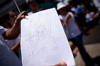 A protestor against the President of Guatemala displays a cartoon portraying the president as a liar as citizens take to the streets as a day of protest in connection with Guatemala's President Alvaro Colom Guatemala City May 17, 2009. . Thousands of protesters took to the streets of the capital  Sunday in two separated rival marches, one in support of the President and one denouncing President Alvaro Colom who was accused this week of murder, money laundering and having ties with narco-traffickers.(Darren Hauck)