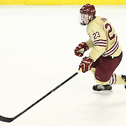 Patrick Brown #23 of the Boston College Eagles with the puck during The Beanpot Championship Game at TD Garden on February 10, 2014 in Boston, Massachusetts. (Photo by Elan Kawesch)