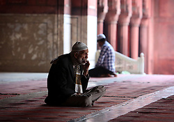 © Licenced to London News Pictures. 26//11/2014. Delhi. India.  <br /> Muslims are pictured  in the Jama Masjid mosque in Old Delhi, India, November 26th 2014. Commissioned by the Mughal Emperor Shah Jahan, it is the best-known mosque in India.<br /> Photo Credit: Susannah Ireland