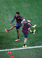 Daniel Sturridge of England (L) warms up and stretches during the England training session at Arena Corinthians, Sao Paulo, Brazil, on the eve of their World Cup 2014 Group D match against Uruguay.<br /> Picture by Andrew Tobin/Focus Images Ltd +44 7710 761829<br /> 18/06/2014
